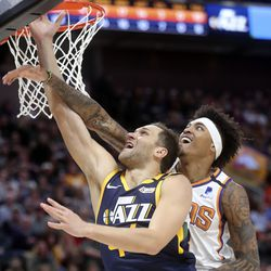 Utah Jazz forward Bojan Bogdanovic (44) shoots as Phoenix Suns forward Kelly Oubre Jr. (3) tries to block the shot during an NBA game at the Vivint Smart Home Arena in Salt Lake City on Monday, Feb. 24, 2020.