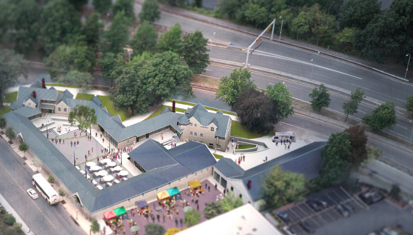 An aerial rendering shows a complex with courtyards next to a roadway