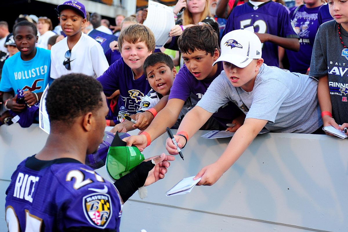 Ray Rice signed autographs after Baltimore's practice in Annapolis, Md. a year ago.