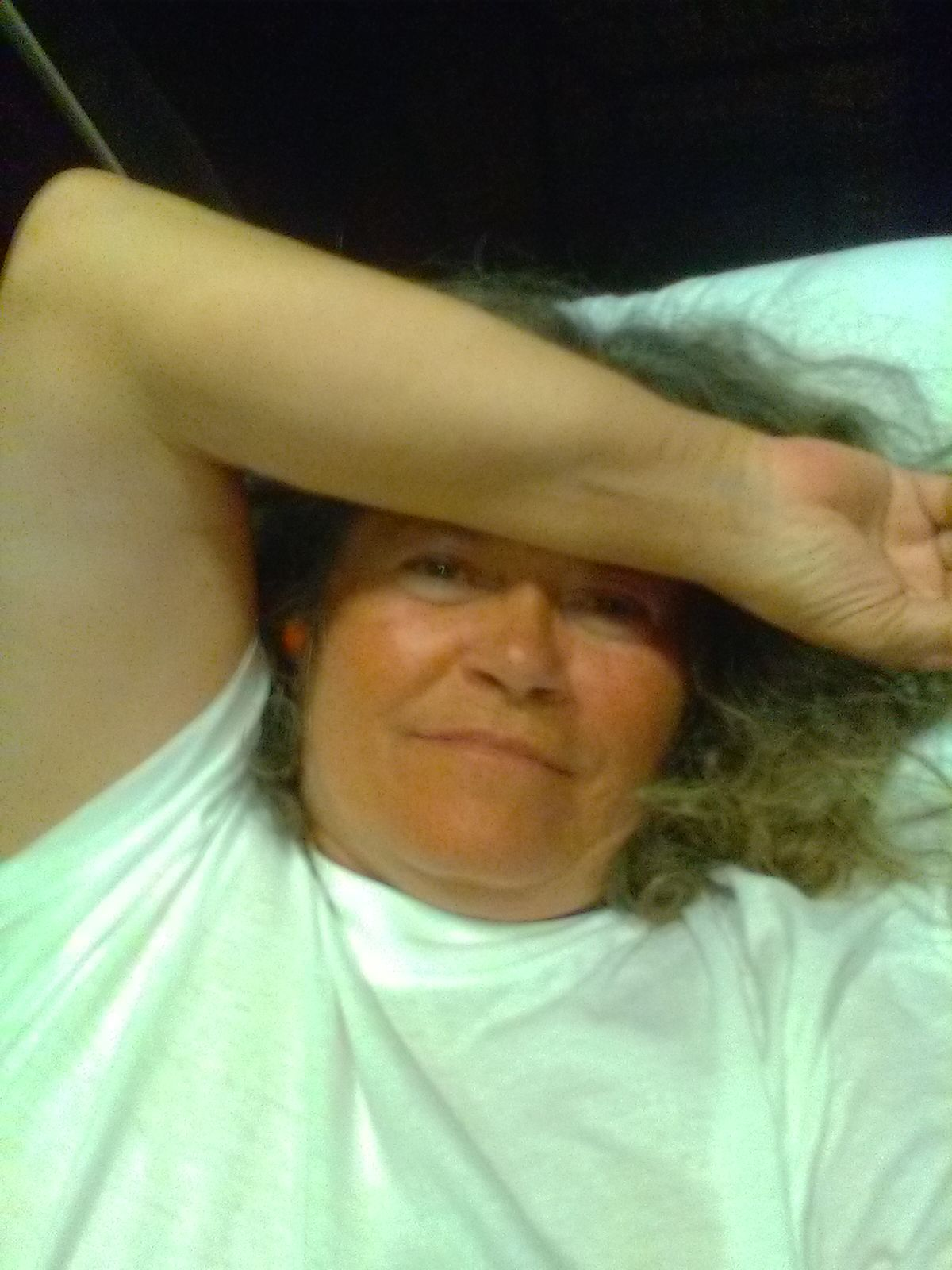 LuAnn Miller, a homeless client, takes a selfie while recovering from an illness in the care of Salt Lake County officials.
