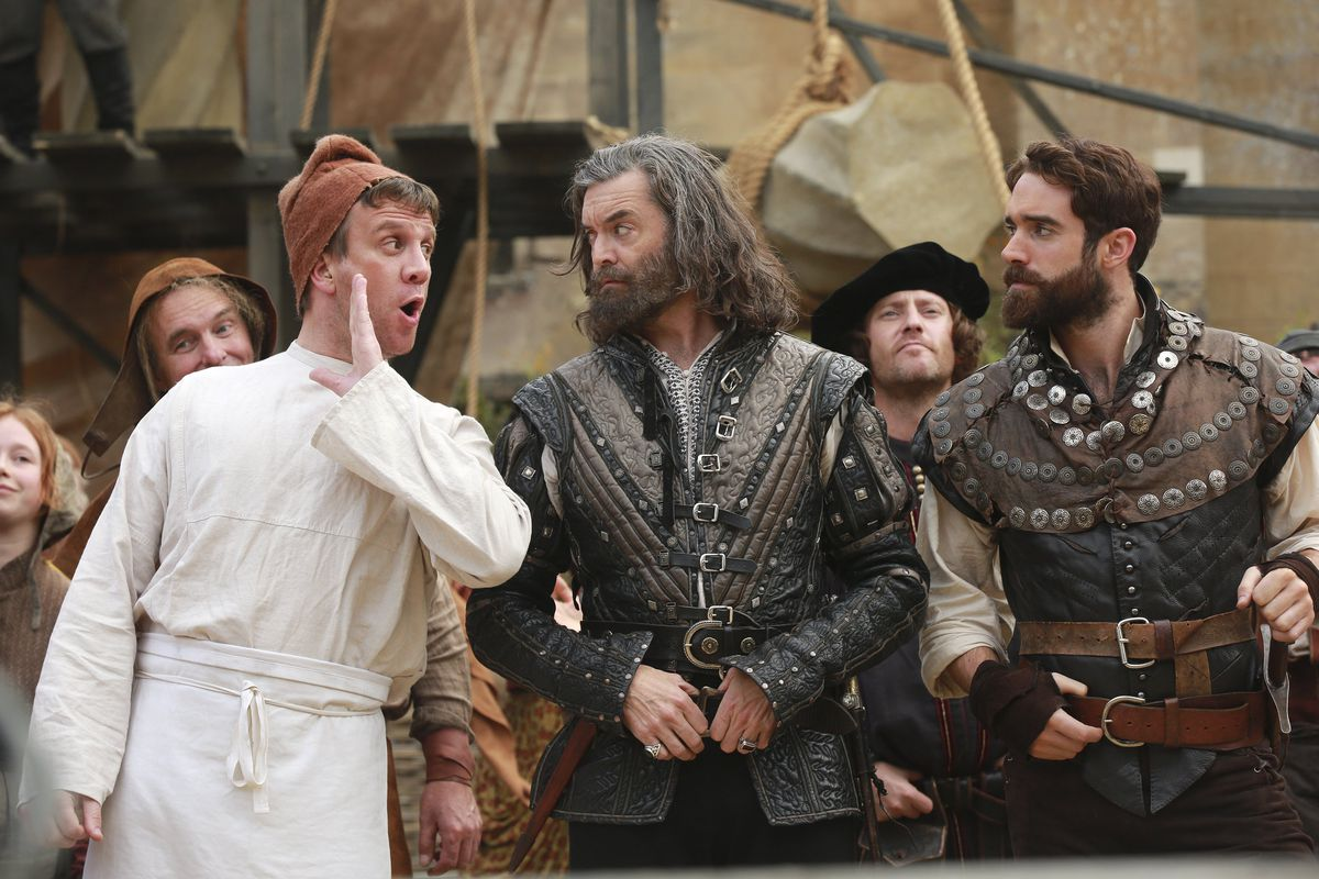 A man whispers something to Sir Galavant (Joshua Sasse) and King Richard (Timothy Omundson) in a screencap from Galavant