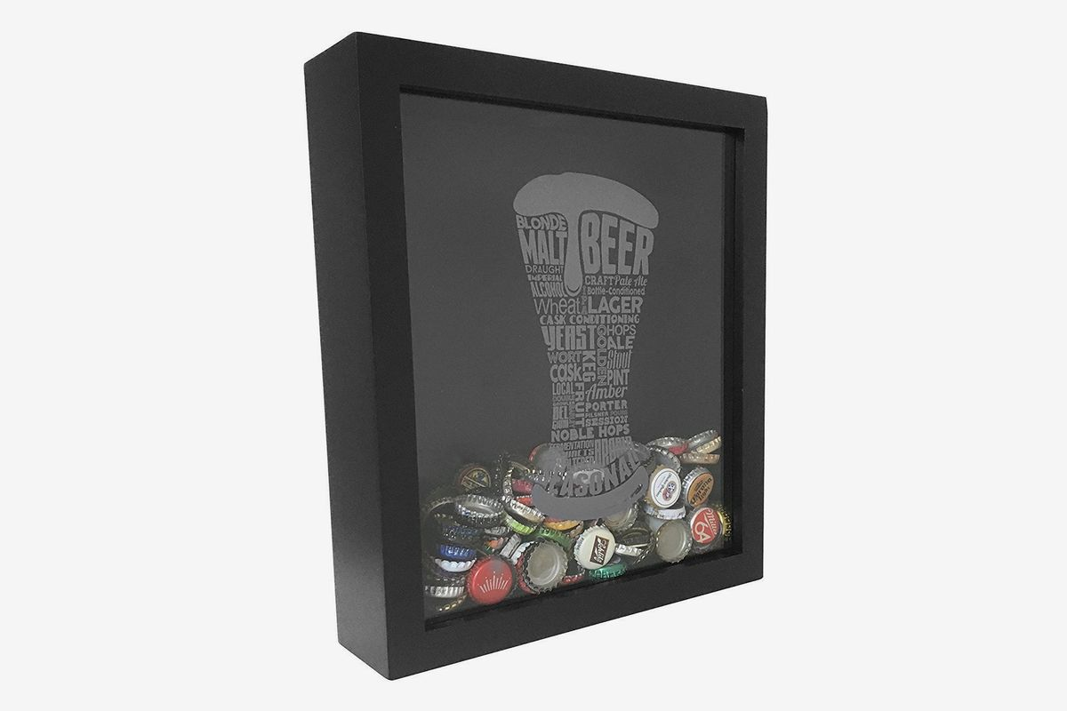 A black shadow box with beer bottle caps on the inside