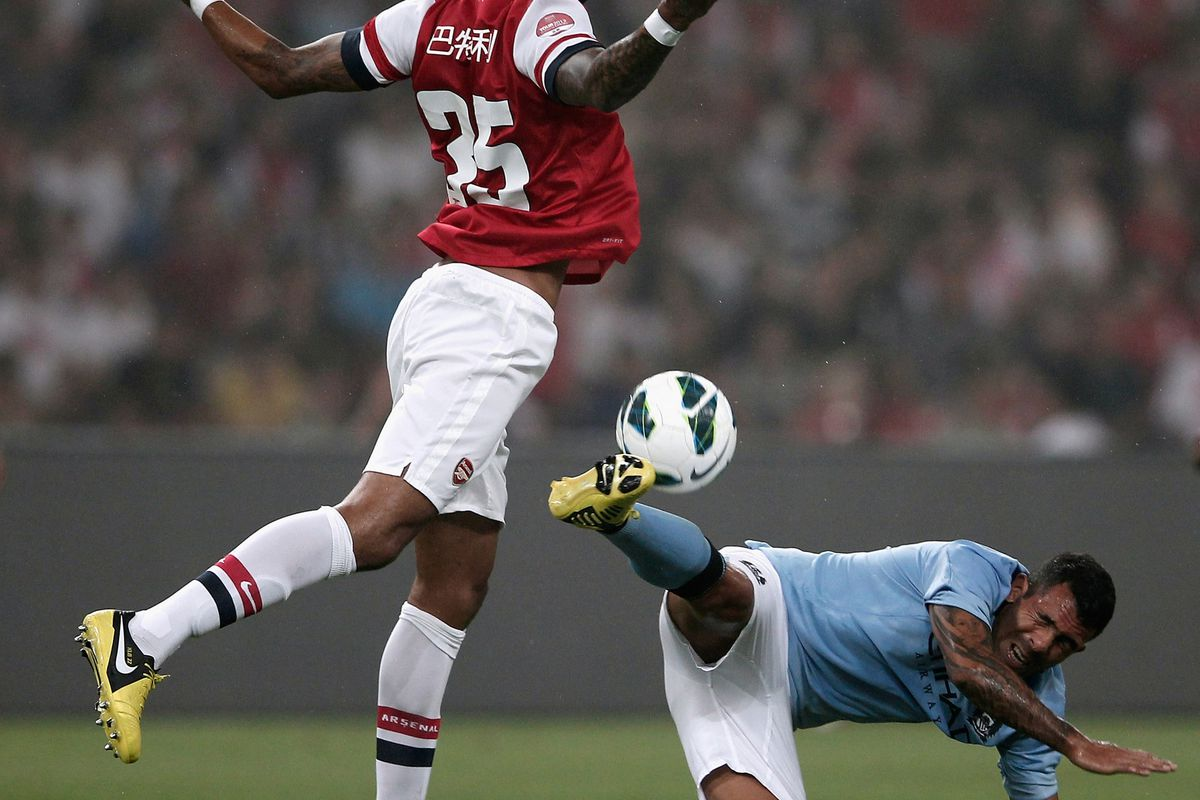 I got tired of the same two pictures of Sahin and Cazorla, so here's Carlos Tevez trying to kick Kyle Bartley in the groin