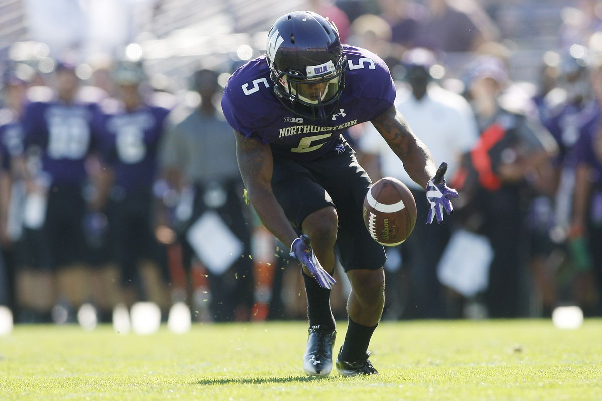 Sep 15, 2012; Evanston, IL, USA; Northwestern Wildcats running back Venric Mark (5) fields a punt against the Boston College Eagles during the first quarter at Ryan Field.  Mandatory Credit: Jerry Lai-US PRESSWIRE
