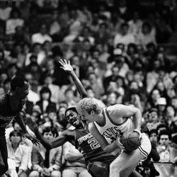 Milwaukee Buck Junior Bridgeman (2) reacts as Boston Celtics Larry Bird, right, makes contact as he drives to the basket during first period NBA playoff action at the Boston Garden, Thursday, May 17, 1984, Boston, Mass. (AP Photo/David Tenenbaum)