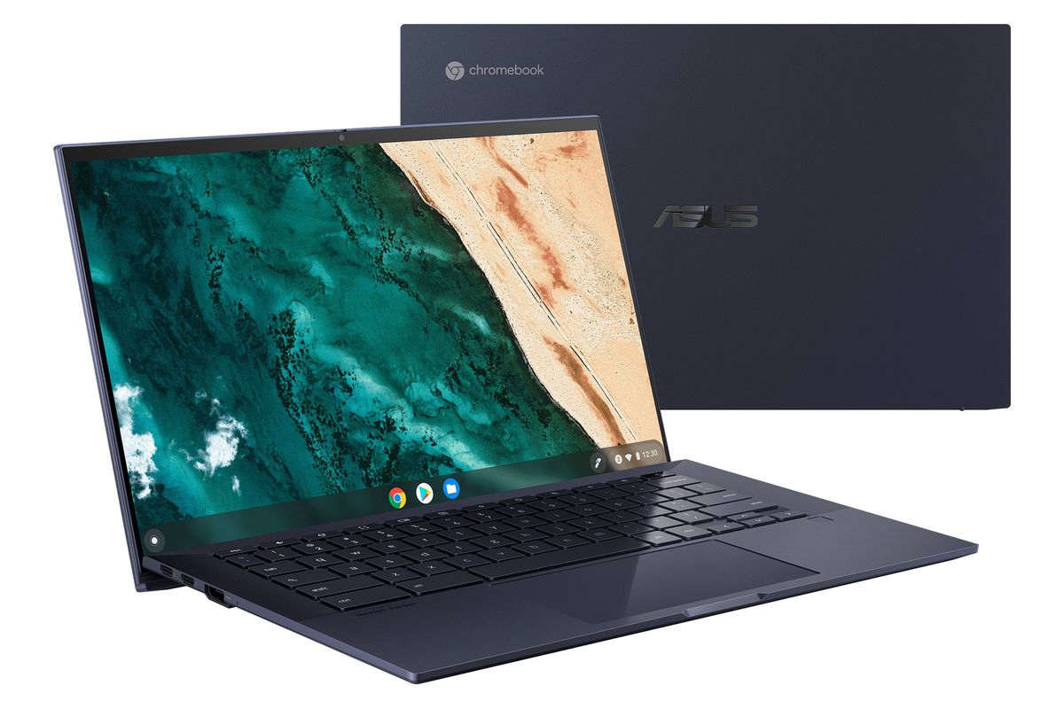 Two models of the Asus Chromebook CX9 sit perpendicular to each other. The one facing the camera displays a birds-eye view of a shoreline.