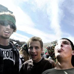An unidentified man, at right, exhales a plume of smoke after smoking a marijuana cigarette in the crowd of marijuana supporters outside of the Duane Physics building during the 4/20 rally on the University of Colorado campus in Boulder, Colo., on Friday, April 20, 2012. Many students at the University of Colorado and other campuses across the country have long observed 4/20. The counterculture observation is shared by marijuana users from San Francisco's Golden Gate Park to New York's Greenwich Village.