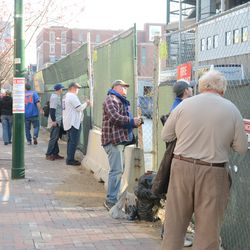 5:24 p.m. Taking photos along the Sheffield fence -