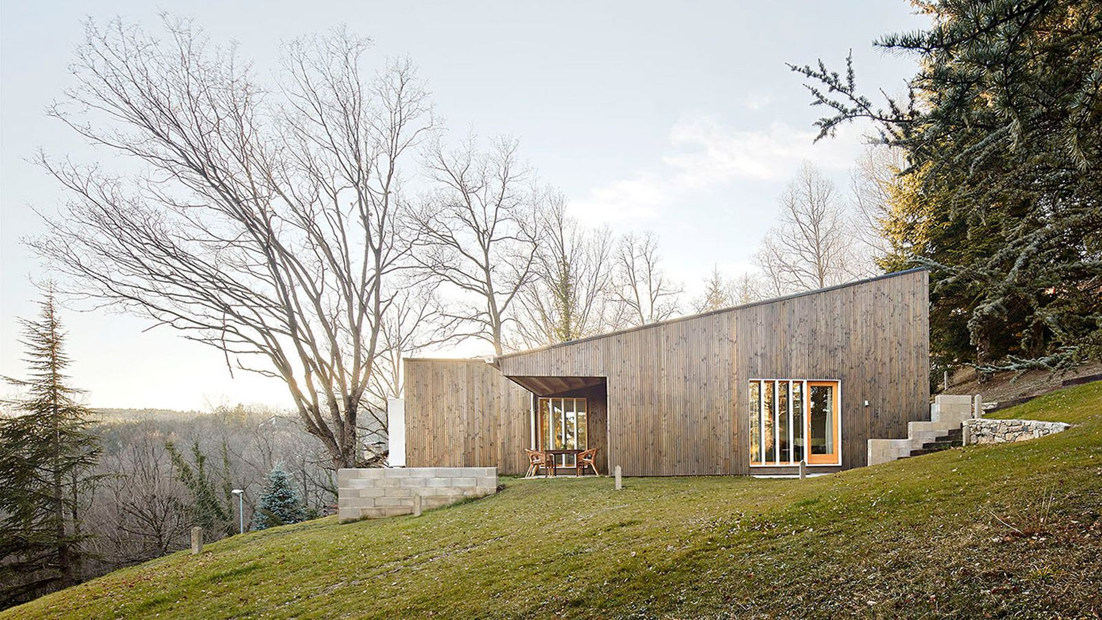 Prefab cottage designed as a cost conscious summer retreat for Building a cottage cost