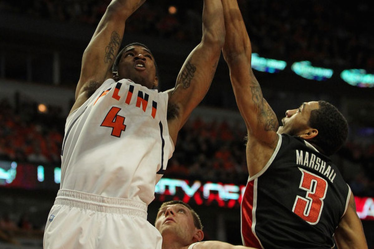 CHICAGO, IL - DECEMBER 17: Anthony Marshall #3 of the UNLV Rebels forces a jump ball on a shot by Crandall Head #4 of the Illinois Fighting Illini at United Center on December 17, 2011 in Chicago, Illinois. (Photo by Jonathan Daniel/Getty Images)