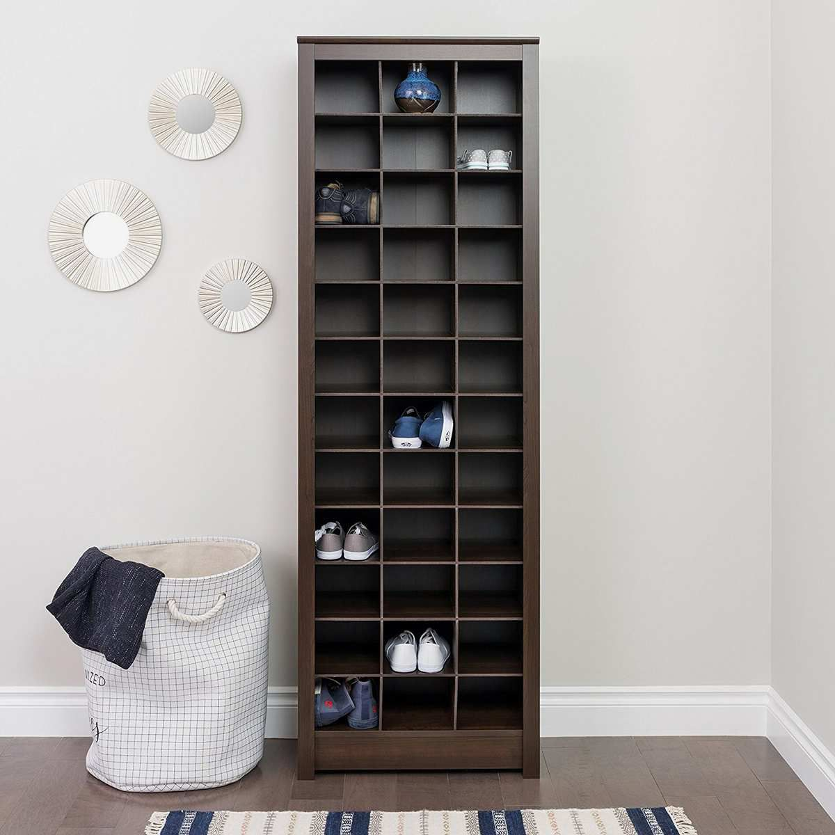 A brown shelf with lots of holes for shoes.