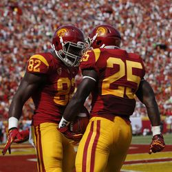 Southern California running back Silas Redd, right, celebrates his touchdown with tight end Randall Telfer during the first half of an NCAA college football game against California in Los Angeles, Saturday, Sept. 22, 2012.