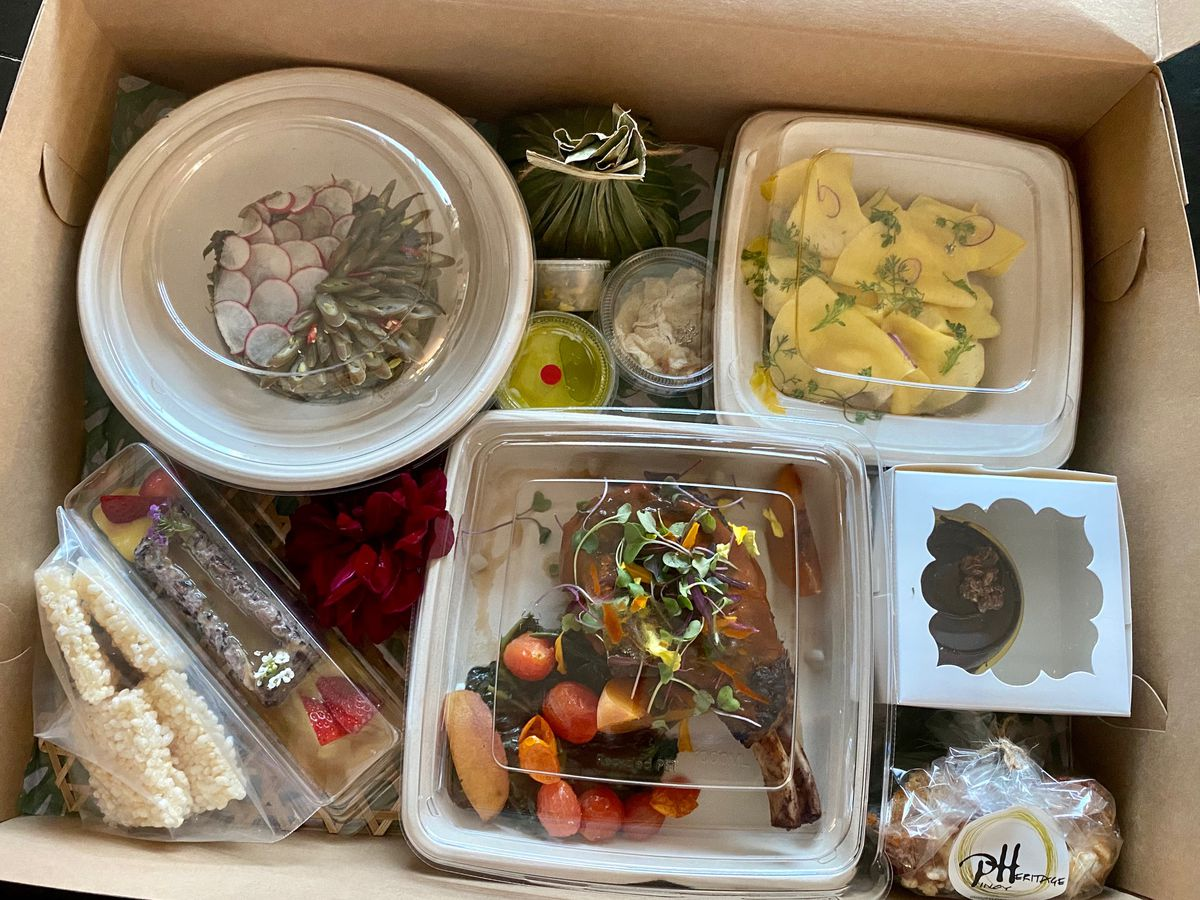 Takeout box for a Filipino tasting menu, with many courses boxed up in microwavable containers