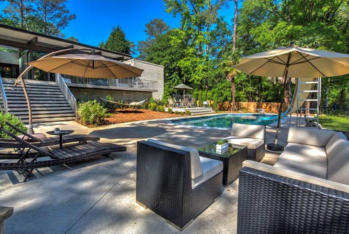 refreshed midcentury modern in buckhead flaunts saltwater pool  sheer space at  850k