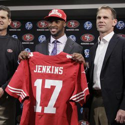 San Francisco 49ers first round draft pick  A.J. Jenkins, center, a wide receiver from Illinois, holds up his new 49ers jersey with head coach Jim Harbaugh, left, and general manager Trent Baalke, right, during an NFL football news conference at the team's headquarters in Santa Clara, Calif., Friday, April 27, 2012.