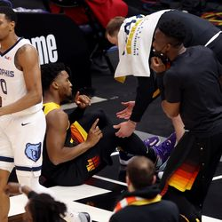 Utah Jazz guard Donovan Mitchell (45) motions to teammate Utah Jazz guard Joe Ingles (2) after taking another fall as the Utah Jazz and Memphis Grizzlies play Game 2 of their NBA playoffs first round series at Vivint Arena in Salt Lake City on Wednesday, May 26, 2021. Utah won 141-129.