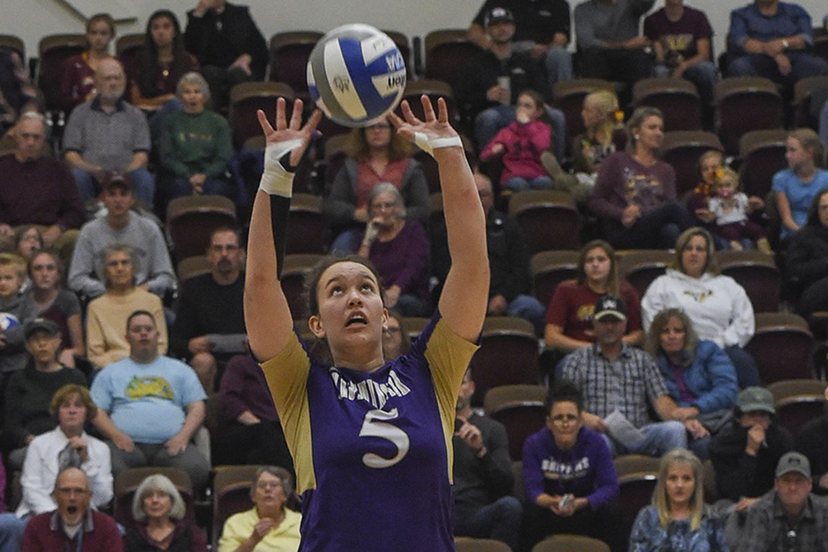 Aggie Roese-Olsen sets the ball for an attack.