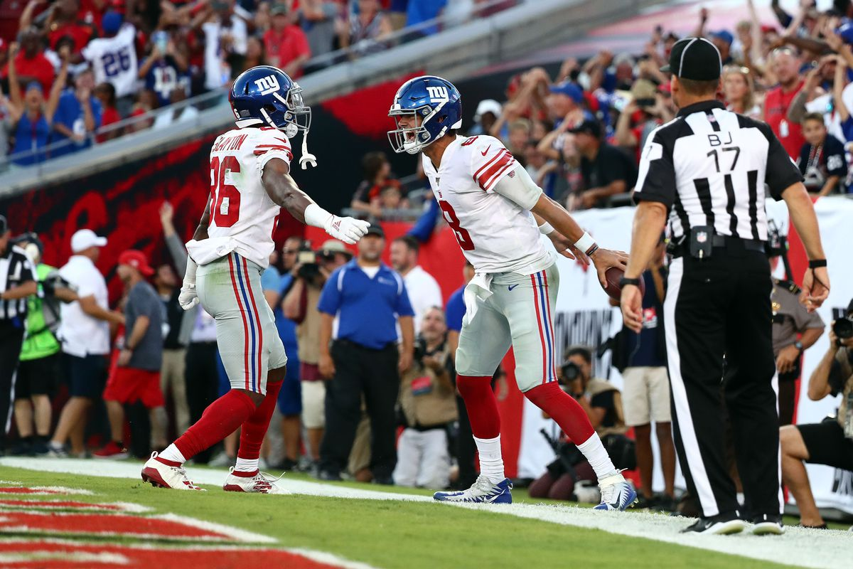 New York Giants quarterback Daniel Jones is congratulated by wide receiver Darius Slayton after running the ball in for the game winning touchdown against the Tampa Bay Buccaneers during the second half at Raymond James Stadium.