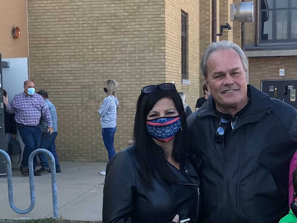 Kimberly Ziesemer and her fiancé, Dennis Woolum, voted at Manteno Middle School on Tuesday.