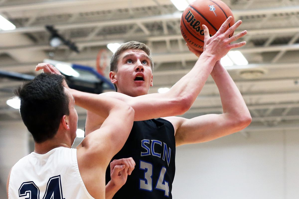 St. Charles North's Connor Linke (34) hits a shot from close in against Lake Park.