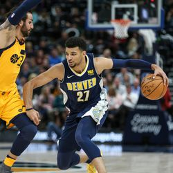 Denver Nuggets guard Jamal Murray (27) drives against Utah Jazz guard Ricky Rubio (3) at Vivint Smart Home Arena in Salt Lake City on Tuesday, Nov. 28, 2017.