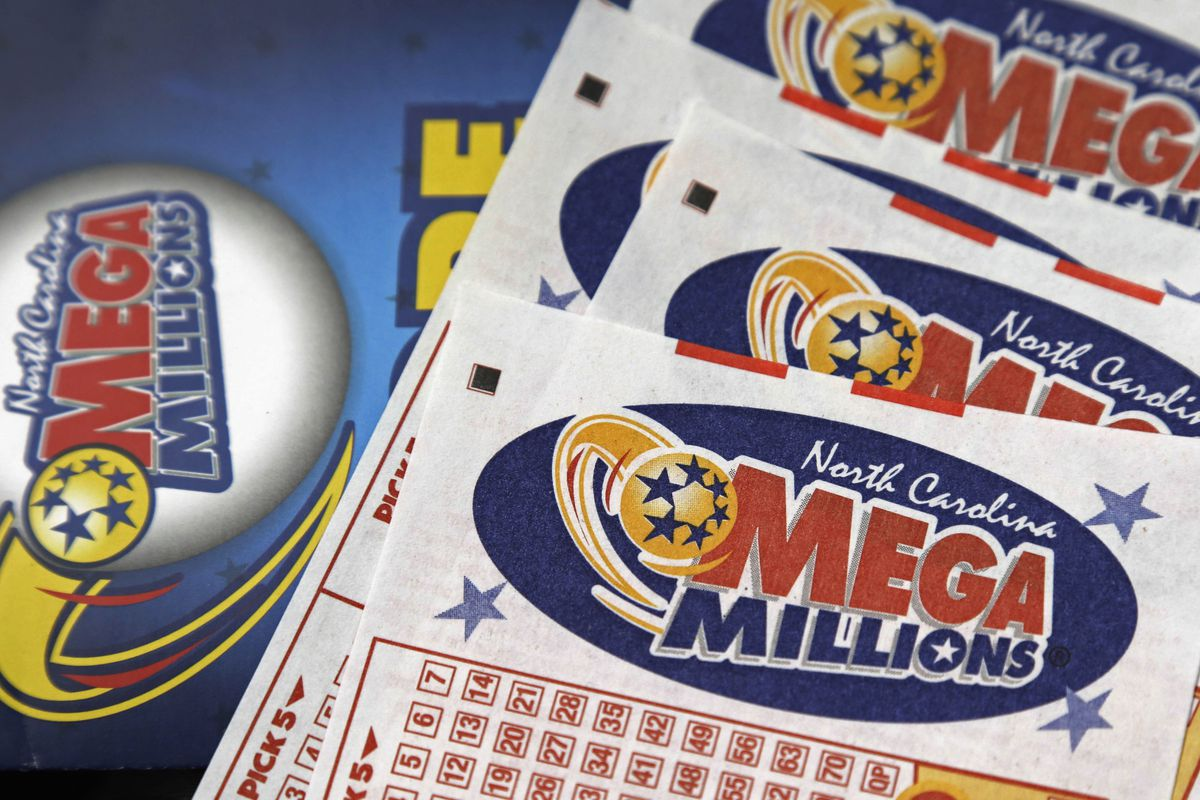 FILE - This July 1, 2016, file photo shows Mega Millions lottery tickets on a counter at a Pilot travel center near Burlington, N.C.