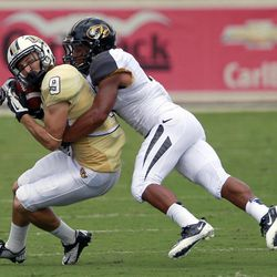 Central Florida wide receiver J.J. Worton (9) is tackled by Missouri defensive back Randy Ponder after a short reception during the first half of an NCAA college football game, Saturday, Sept. 29, 2012, in Orlando, Fla.