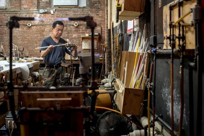 Glassblower Jimmy Vu at work in his studio