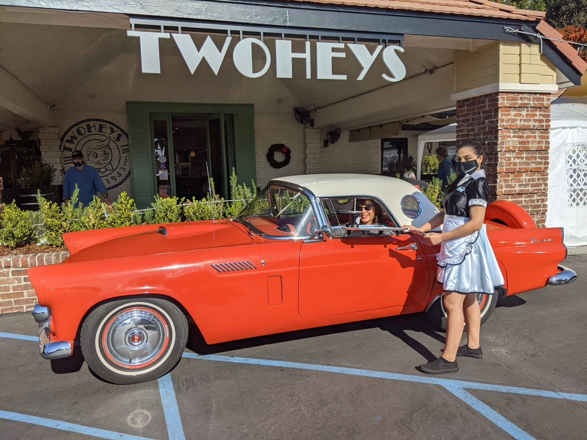 Trompers of Eagle Rock Car Club, the first customers to experience Twohey's curbside car hop in South Pasadena, California