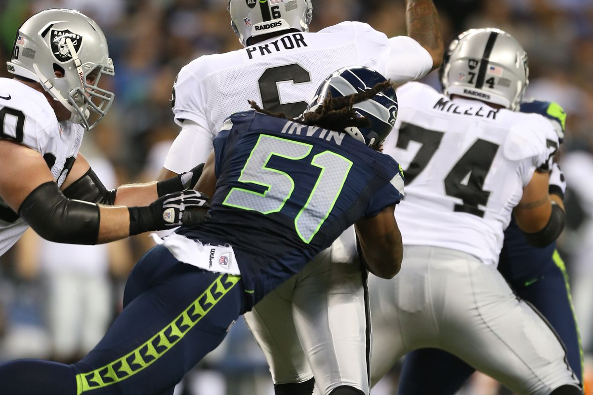 Defensive end Bruce Irvin #51 of the Seattle Seahawks pressures quarterback Terrelle Pryor #6 of the Oakland Raiders