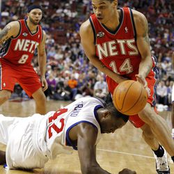 New Jersey Nets guard Gerald Green (14) grabs the loose ball from Philadelphia 76ers forward Elton Brand (42) in the second half of an NBA basketball game on Friday, April 13, 2012, in Philadelphia. The Nets won 95-89. (AP Photo/Alex Brandon)