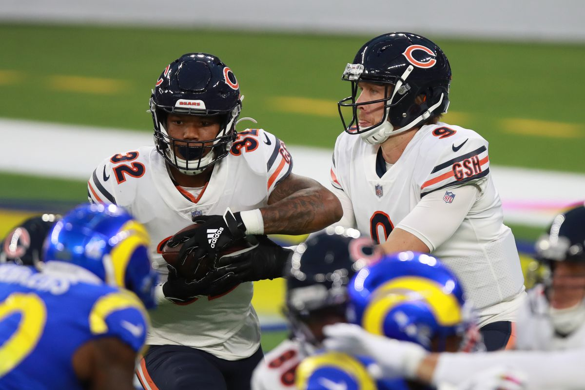 David Montgomery runs the ball against the Rams on Monday.