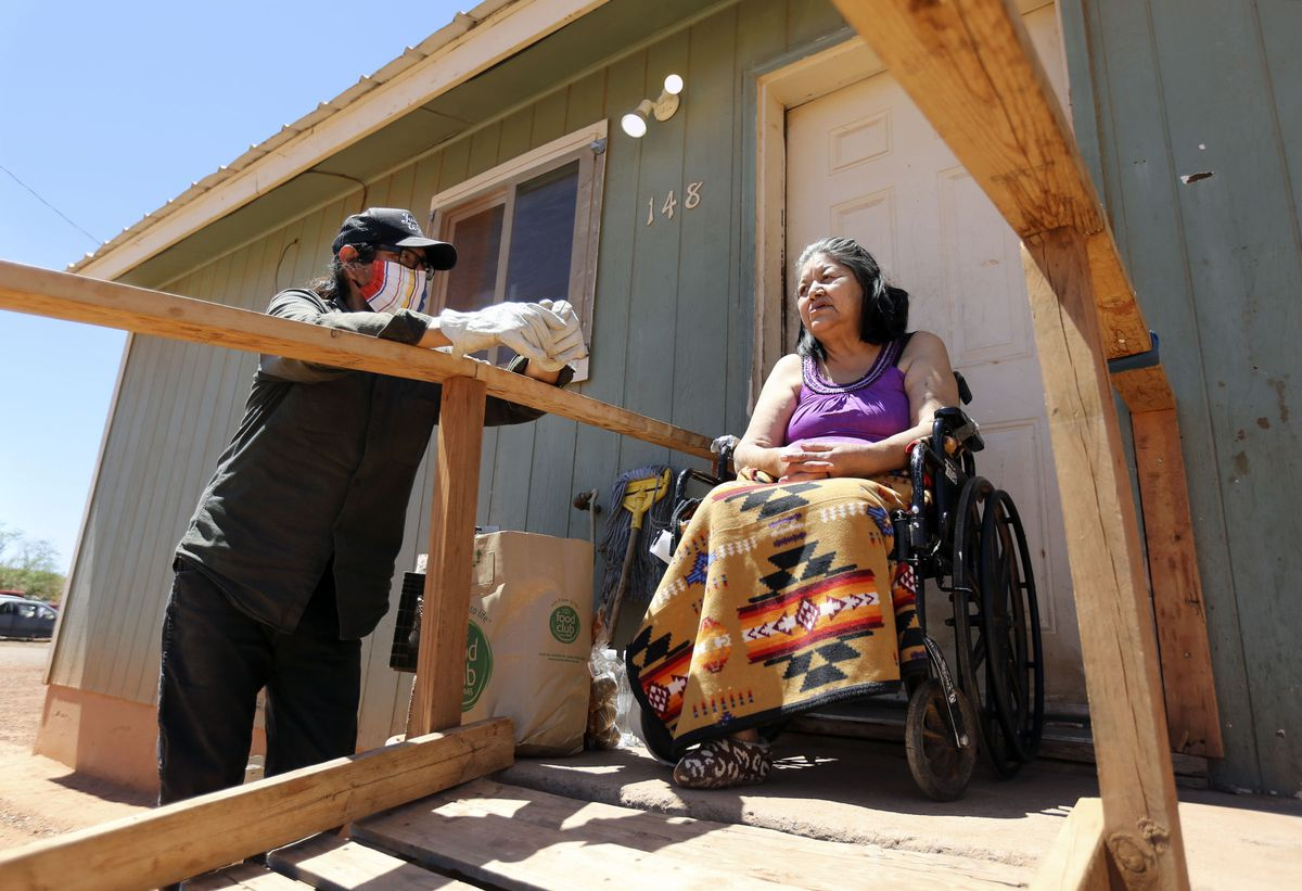 Pete Sands, Utah Navajo COVID-19 Reliefprogramproject manager, chats with Mary Lou Clark after delivering food to her outside of her home in Halchita, San Juan County, on Wednesday, April 29, 2020. TheNavajo Nation has one of the highest per capita COVID-19 infection rates in the country.