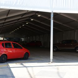 4:33 p.m. Inside the players/VIP parking lot tent -