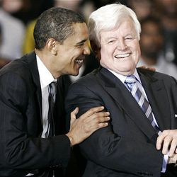 Democratic presidential hopeful Sen. Barack Obama, D-Ill., laughs with Sen. Ted Kennedy, D-Mass., during a rally for Obama at American University on Jan. 28, 2008, in Washington.