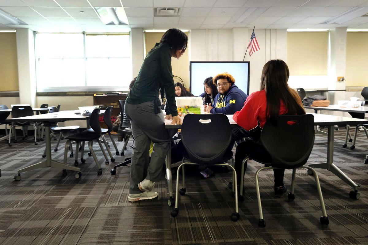 Teacher talks with students inside a classroom at Crispus Attucks High School, a public school in Indianapolis, Indiana. —April 2019