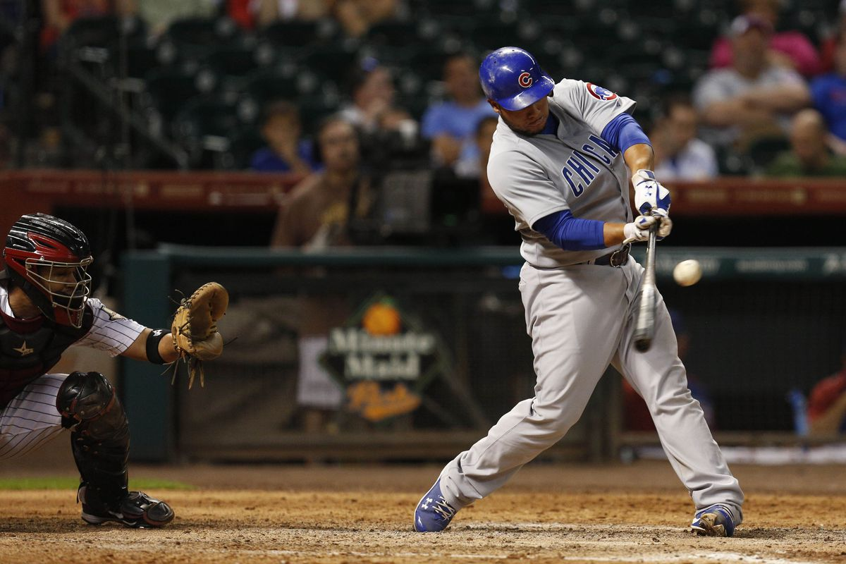 Houston, TX, USA; Chicago Cubs catcher Welington Castillo hits a single to center field against the Houston Astros at Minute Maid Park. Credit: Thomas Campbell-US PRESSWIRE