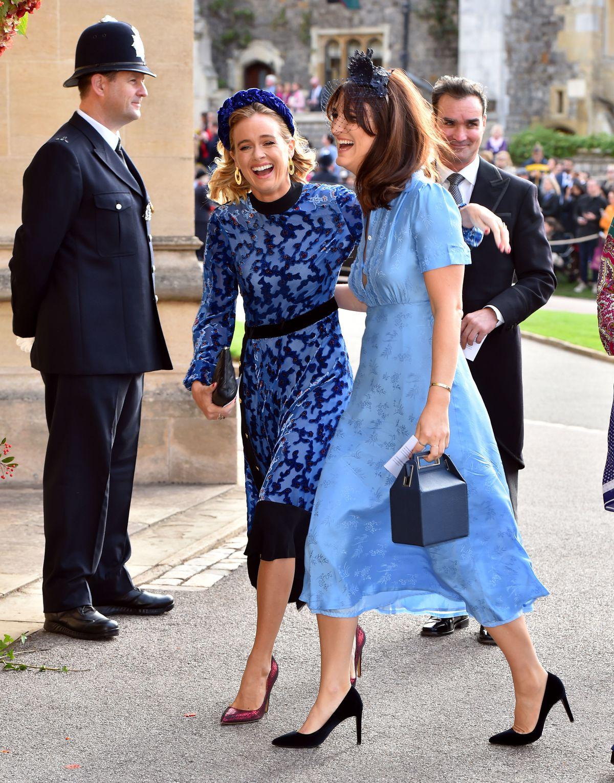 Cressida Bonas walks arm in arm with a friend.