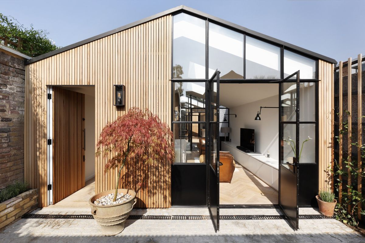 Modern home in london works magic on an awkward lot curbed for Modern architecture house london