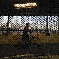 A pedestrian crosses the Gateway International Bridge from Brownsville, Texas, to Matamoros, Tamaulipas, Mexico, on Monday, Feb. 22, 2021 .