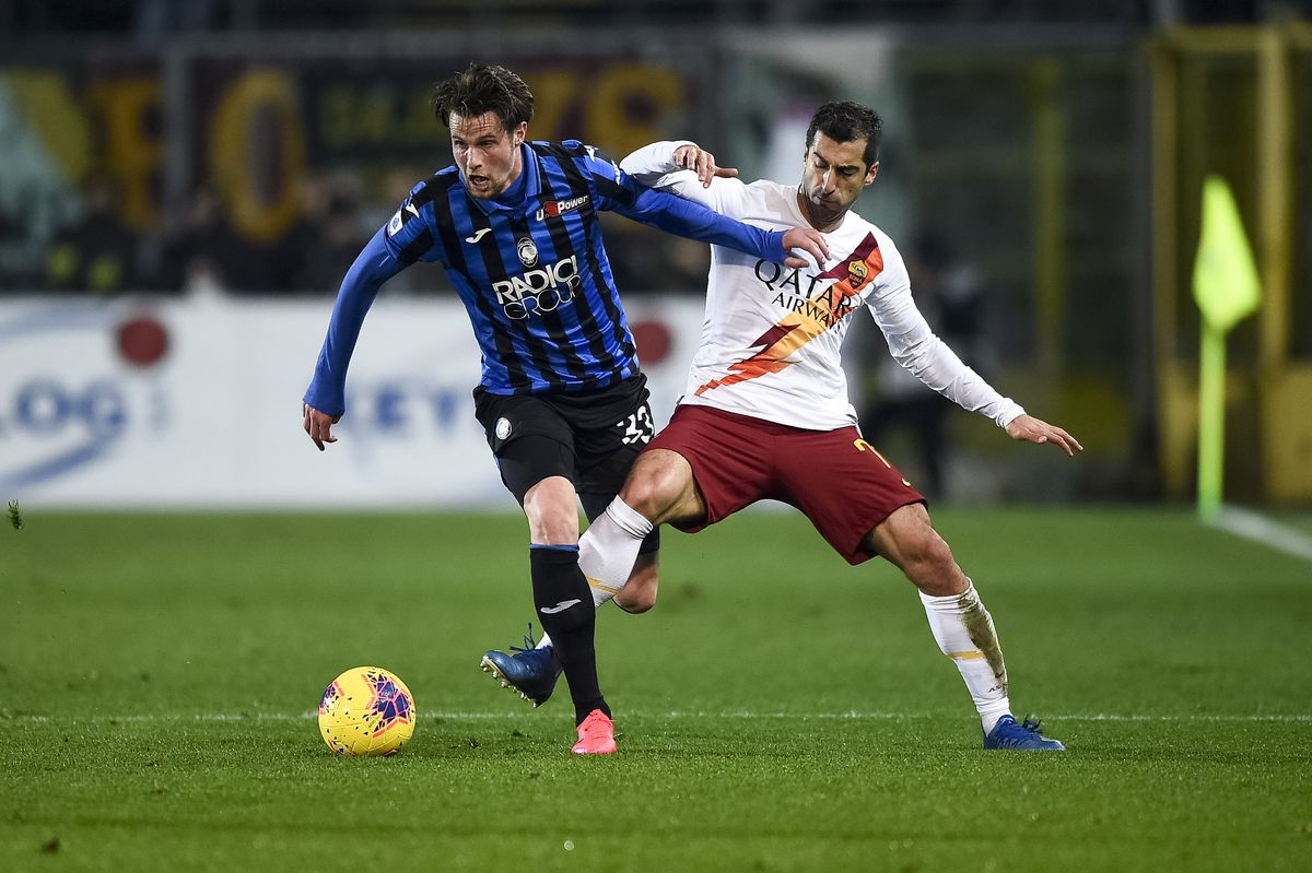 Henrikh Mkhitaryan (R) of AS Roma competes for the ball with...