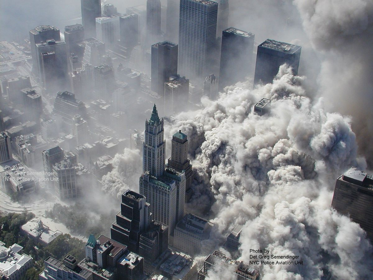In this Sept. 11, 2001 photo made by the New York City Police Department and provided by ABC News Tuesday Feb. 9, 2010, smoke and ash engulf lower Manhattan after terrorists flew two airliners into the World trade Center towers.