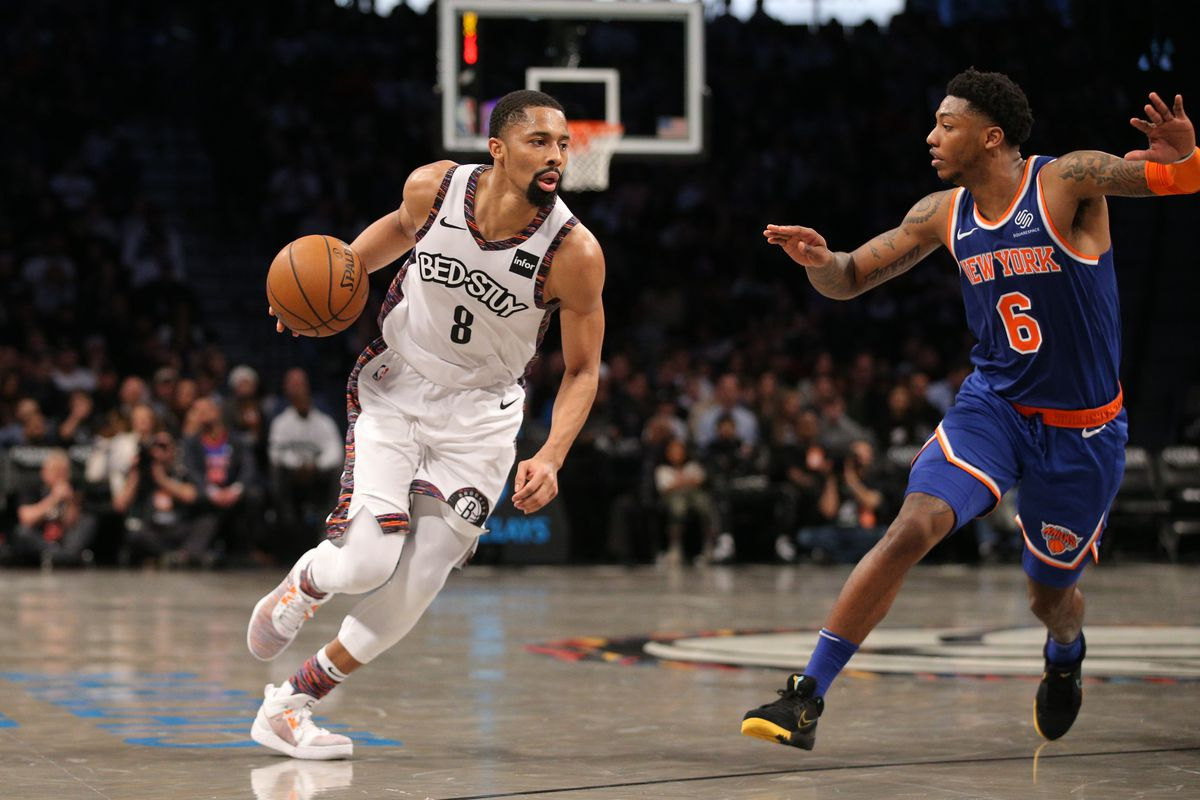Brooklyn Nets point guard Spencer Dinwiddie drives the ball against New York Knicks point guard Elfrid Payton during the third quarter at Barclays Center.