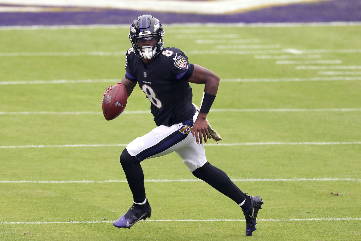 Quarterback Lamar Jackson #8 of the Baltimore Ravens drops back to pass against the Tennessee Titansat M&T Bank Stadium on November 22, 2020 in Baltimore, Maryland.