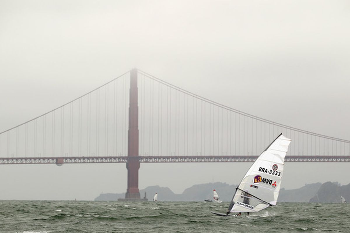 SAN FRANCISCO - JULY 20:  Paulo do Reis sails near the Golden Gate Bridge during day 1 of the US Windsurfing National Championships hosted by the St. Francis Yacht Club on July 20 2010 in San Francisco California.  (Photo by Ezra Shaw/Getty Images)