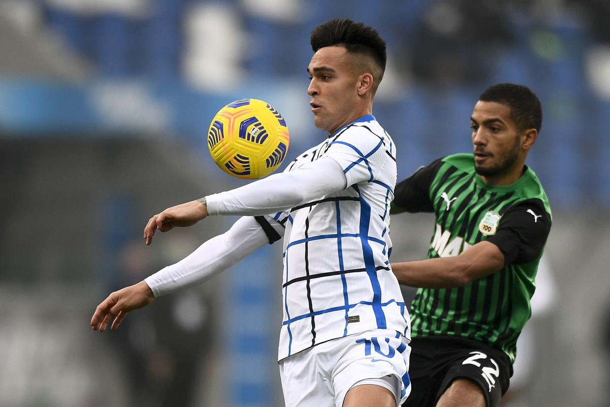 Lautaro Martinez (C) of FC Internazionale is challenged by...