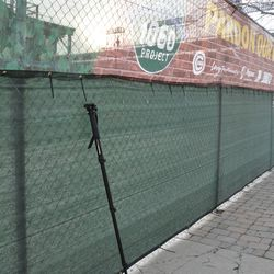 My 5 foot long photo monopod leaning against the Waveland Avenue fence