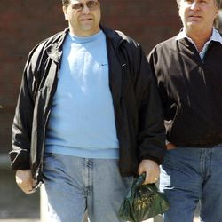 This March 25, 2002 photo shows Carmen Anthony DiNunzio, left, walking with Anthony Gambale, right, on Hanover Street in Boston's North End. A spokesman for the Rhode Island U.S. Attorney's Office said Anthony DiNunzio was taken into FBI custody and is scheduled to be in federal court in Providence, R.I., Wednesday afternoon April 25, 2012.