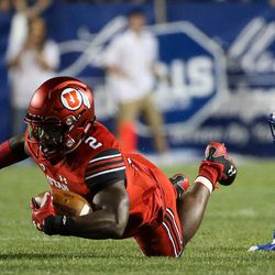 Utah Utes running back Zack Moss (2) carries the ball at LaVell Edwards Stadium in Provo on Saturday, Sept. 9, 2017.