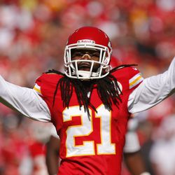 Dunta Robinson #21 of the Kansas City Chiefs signals to the fans to get louder before a third down play against the Oakland Raiders in the third quarter October 13, 2013 at Arrowhead Stadium in Kansas City, Missouri.